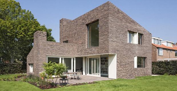 La casa in laterizio che rivisita la tradizione olandese for Case in stile mattone